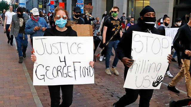 People march through the streets of downtown Pittsburgh on Sunday protesting the death of George Floyd. Floyd died May 25 after he was pinned at the neck by a Minneapolis police officer.