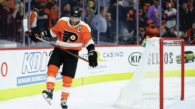 Philadelphia Flyers' Claude Giroux reacts after a 2020 loss to the Boston Bruins.