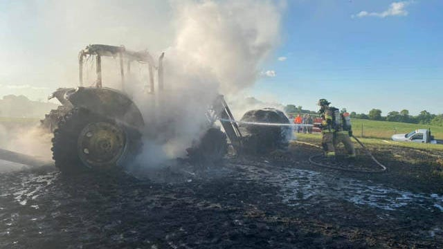 Volunteer firefighters respond to the scene of a tractor fire on Tuesday, June 2, 2020.
