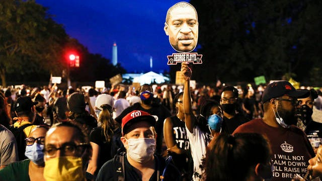 Demonstrators protest Saturday near the White House in Washington, over the death of George Floyd, a black man who was in police custody in Minneapolis. Floyd died after being restrained by Minneapolis police officers.