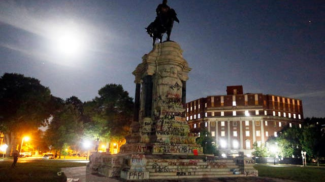 The Moon illuminates the statue of Confederate General Robert E. Lee on Monument Avenue on June 5 in Richmond, Va. Virginia Gov. Ralph Northam has ordered the removal of the statue.