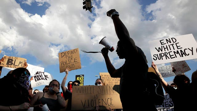 In this June 3 file photo, people protest in Kansas City, Mo., during a unity march to protest against police brutality following the death of George Floyd, who died after being restrained by Minneapolis police officers on May 25. Since Floyd's killing, police departments have banned chokeholds, Confederate monuments have fallen and officers have been arrested and charged. The moves come amid a massive, nationwide outcry against violence by police and racism.