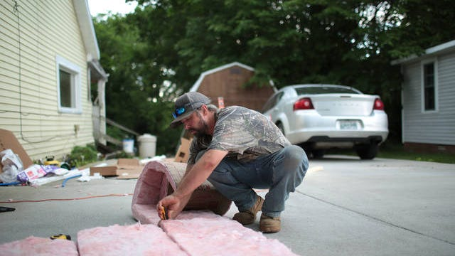 Build and Learn student Chris Head cuts insulation for a Columbia home last week.
