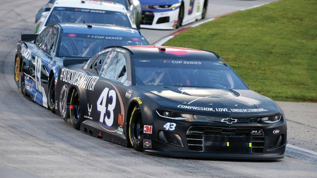 Bubba Wallace (43) drives during a NASCAR Cup Series race in Martinsville, Va.