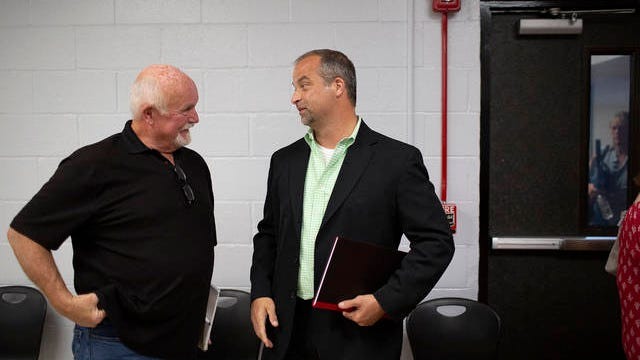 Maury County Public Schools board member Denny Beaver, left, speaks with incoming Superintendent Michael Hickman following a meeting of the Maury County Board of Education naming Hickman the next superintendent of the school district at Horace O. Porter School in Columbia on June 8.