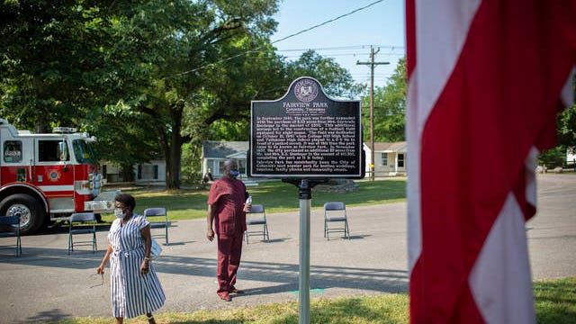 Patricia Martin Bowman, left, and Maury County Commissioner Gary Stovall, right, stand at a newly unveiled historical marker during a Juneteenth celebration at Fairview Park in Columbia, Tenn., on Friday, June 19, 2020.