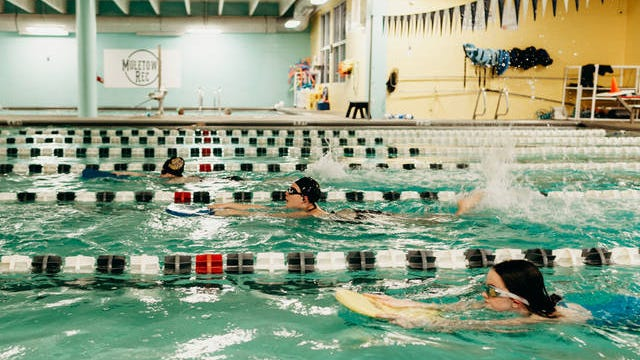 Young swimmers train in an indoor pool at Muletown Rec before the pool's closing earlier this year.