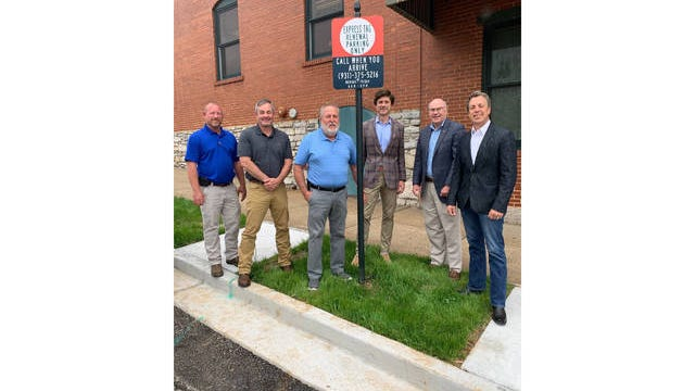 Maury County Clerk Joey Allen, center left, and Columbia Mayor Chaz Molder, center right, are joined by City Manger Tony Massey, second from right, and County Mayor Andy Ogles, right, and Maury County Public Works Director Jeff Dewire , second from left, and Maury County Public Works Assistant Director Jeff Riggins, left, as they pose at a new parking space for express tag renewals on the Maury County Courthouse square.
