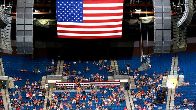 President Donald Trump supporters listen as Trump speaks during a campaign rally at the BOK Center on Saturday in Tulsa, Okla.