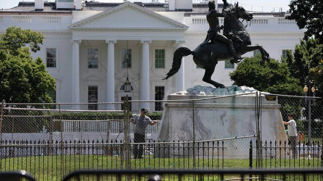 The base of the statue of former president Andrew Jackson is power washed inside a newly closed Lafayette Park, Wednesday in Washington, which has been the site of protests over the death of George Floyd, a black man who was in police custody in Minneapolis. Floyd died after being restrained by Minneapolis police officers.