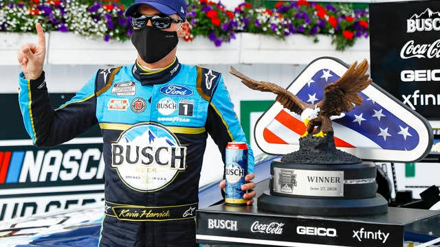Kevin Harvick celebrates in the winners circle after winning the NASCAR Cup Series auto race at Pocono Raceway on Saturday in Long Pond, Pa.