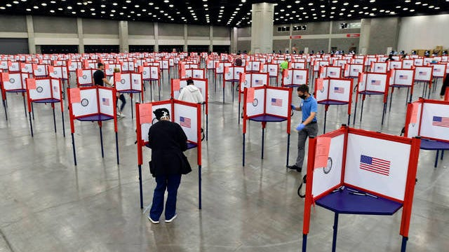 """In this June 23 file photo, voting stations are set up in the South Wing of the Kentucky Exposition Center for voters to cast their ballot in the Kentucky primary in Louisville, Ky. Just over four months before Election Day, President Donald Trump is escalating his efforts to delegitimize the upcoming presidential election. Last week he made a startling, and unfounded, claim that 2020 will be """"the most corrupt election in the history of our country."""""""