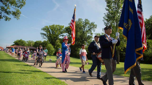The Columbia Rotary Club Independence Day parade marches through Riverwalk Park in Columbia on July 4, 2019.