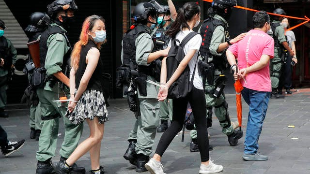Police detain protesters after a protest in Causeway Bay before the annual handover march in Hong Kong on Wednesday. Hong Kong marked the 23rd anniversary of its handover to China in 1997, and just one day after China enacted a national security law that cracks down on protests in the territory. Hong Kong police said on Facebook they had arrested over 30 people on various charges, from unlawful assembly to the violation of a national security law on the first day of the law.