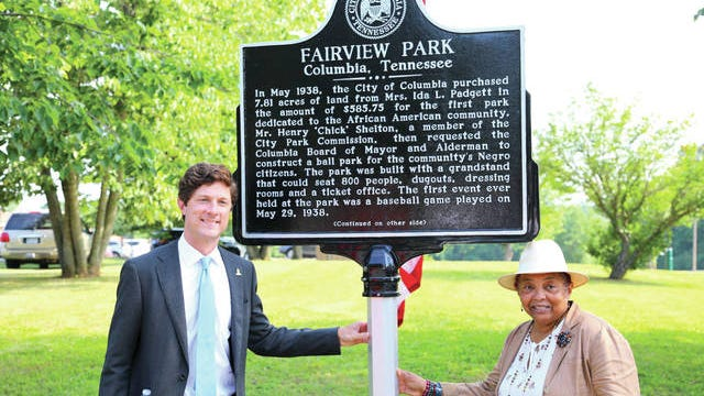 Columbia Mayor Chaz Molder, left, and Vice Mayor Christa Martin unveil a historical marker in June, commemorating Fairview Park.