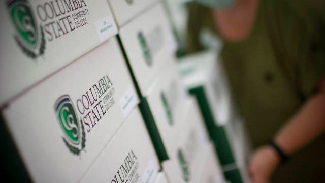 Boxes containing diplomas sit ready to be handed out at a drive-through graduation ceremony in at Columbia State Community College on June 27.