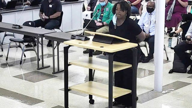 Kimberly Osborne speaks before the MCPS board, calling for transparency in the complete renovation of McDowell Elementary School during the meeting at Horace O. Porter School last week.