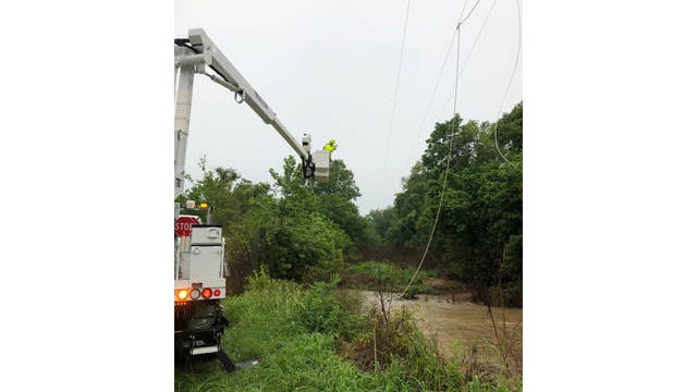 A lineman with the Duck River Electric Membership Corporation works to repair a downed power line in Maury County following a sever thunderstorm on Sunday, July 12, 2020.