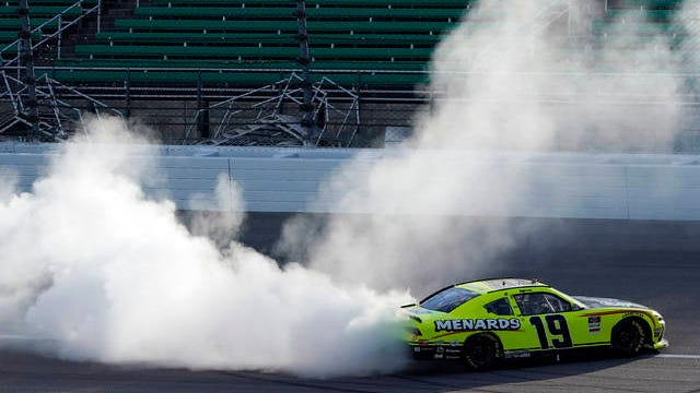 Brandon Jones does a burnout after winning a NASCAR Xfinity Series auto race at Kansas Speedway in Kansas City, Kan., Saturday.
