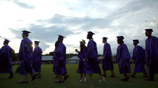 The Columbia Central High School Class of 2018 walks into Lindsey Nelson Stadium for their graduation ceremony on May 22.