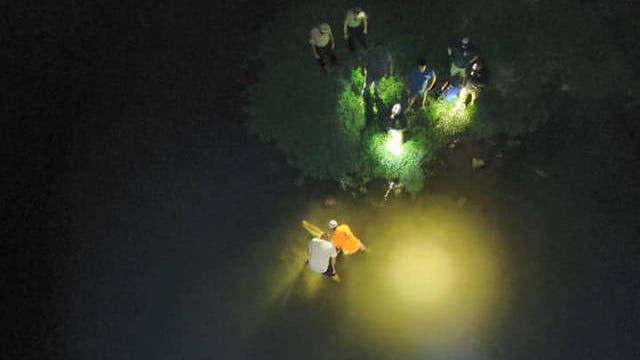 Emergency responders work to recover a person who had fallen from an abandoned bridge in rural Maury County on Monday, July 28, 2020.
