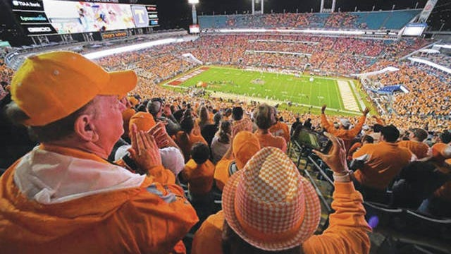 UT fans cheer as the Vols football team takes the field for their matchup against Indiana. The Vols and Hoosiers faced off in the 2020 TaxSlayer Gator Bowl in Jacksonville, Florida.