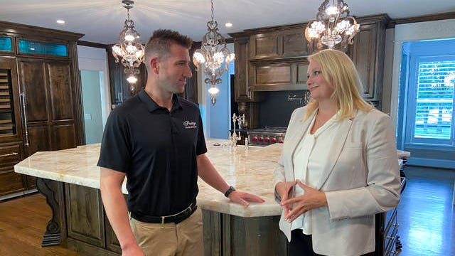 Eric James Smith of Prestige Prestige Marble & Granite appears on screen with host Kimberly Greenwell for an episode of 'My Southern Home with Kimberly Greenwell.'