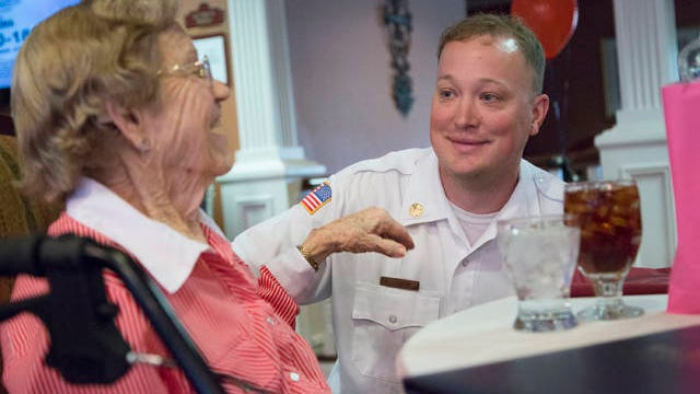 Columbia Fire Chief Ty Cobb speaks with The Bridge at Columbia resident May Murphy during a Sept. 11 memorial brunch held Monday in honoring of the local firefighters.