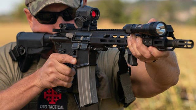 """Bill Toy demonstrates the Head Down Firearms produced OTG Patrol Rifle Package is a a rifle made to be """"reliable, fightable and affordable."""""""