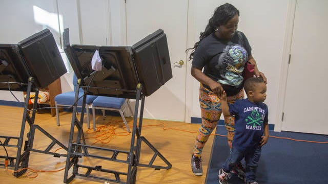 Kelly Johnson is joined by her son Jamie, 3, after voting in the midterm election at True Vine Baptist Church in Columbia on Tuesday Nov. 6, 2018. Johnson said she is voting for the future of her son.