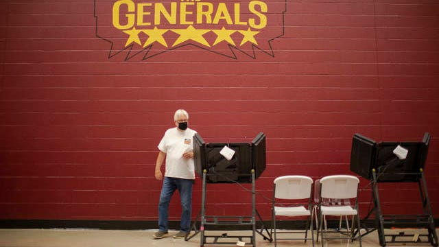 JC Collins, a 34-year employee of General Motors, votes in the county general and state primary election at Spring Hill Middle School in Spring Hill, Tenn., on Thursday, Aug. 6, 2020.