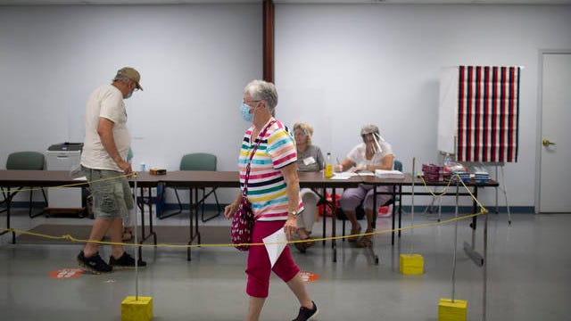 Voters prepare to cast their ballots early at the Maury County Election Commission in Columbia, Tenn., on Friday, July 17, 2020.