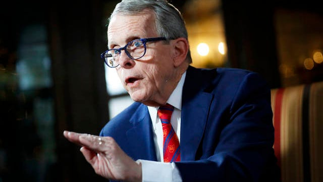 In this Dec. 13, 2019 file photo, Ohio Gov. Mike DeWine speaks during an interview at the Governor's Residence in Columbus, Ohio. The Ohio governor's positive, then false, results on COVID-19 tests threw fuel on the fire for skeptics about pandemic precautions and critics of the often-aggressive policies the governor championed.