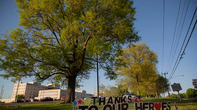 A lawn display celebrating medical professionals and emergency responders sits near the entrance to Maury Regional Medical Center in Columbia on April 10.