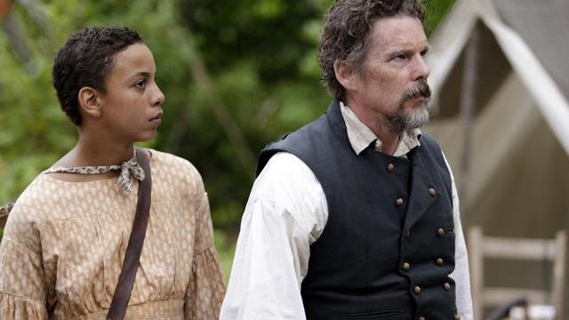 "From left, Joshua Caleb Johnson as Onion and Ethan Hawke as John Brown in ""The Good Lord Bird."""