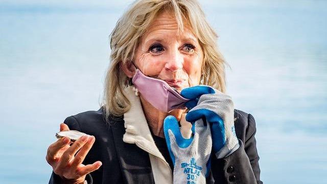 Jill Biden eats an oyster at Fox Point Oysters in Durham Friday.
