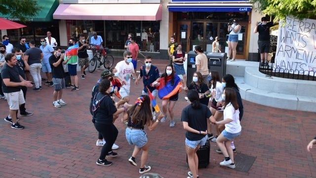 Members of Homenetmen Boston dance during a flash mob demonstration in Cambridge's Harvard Square on July 25.