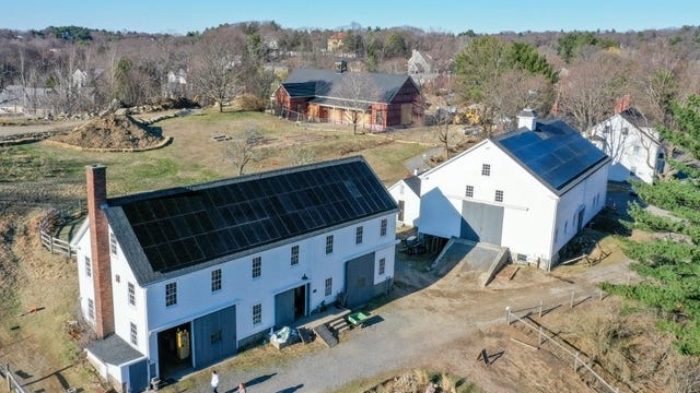 New solar panels are seen on the roofts at Wright-Locke Farm in Winchester.