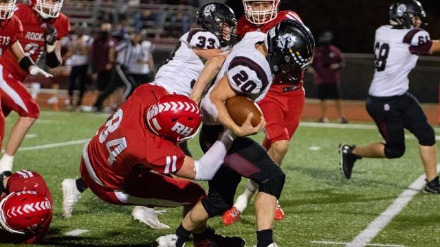 Rose Hill's Brandon Kelly (84) tries to tackle Buhler's Sam Elliott (20) in Friday night's second round game at Rose Hill High School. The Crusaders beat Rose Hill 42-8 to advance to the quarterfinals on Friday, Nov. 13.
