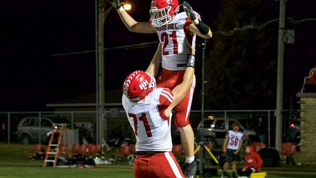 Rose Hill's Noah Bolticoff (71) lifts Bryce Bischler into the air after Bischler scores one of his two touchdowns from Friday night's 28-20 win over Wellington.