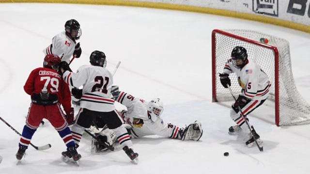 Soo Indians goaltender Aiden Winslow gets some help from the defense during a Saturday night game against the Chicago Young Americans at Taffy Abel Arena.