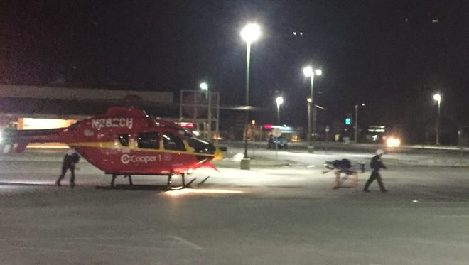 Vineland firefighters set up landing zone in the Lincoln ShopRite ShopRite parking lot for a Cooper University Hospital helicopter.