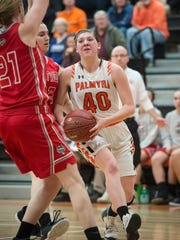 Palmyra's Katelyn Becker pushes past Fleeetwood driving to the hoop in the first round of District 3 Class 5A play Tuesday night, Feb. 20.