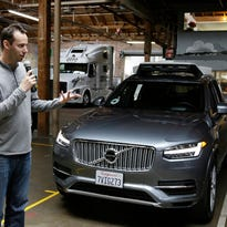 Uber self-driving guru, accused of theft from Google, takes back seat
