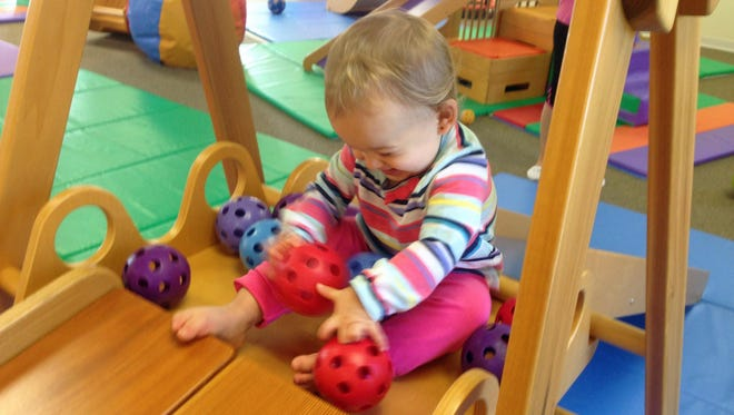 Isabella liked rolling the balls down at other kids. But when the balls were rolled back to her, she laughed hysterically.