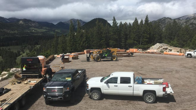 Crews used helicopters to transport some of the material from the Gibson Reservoir Overlook Parking Area to where a pack-bridge in the Bob Marshall Wilderness will be repaired.