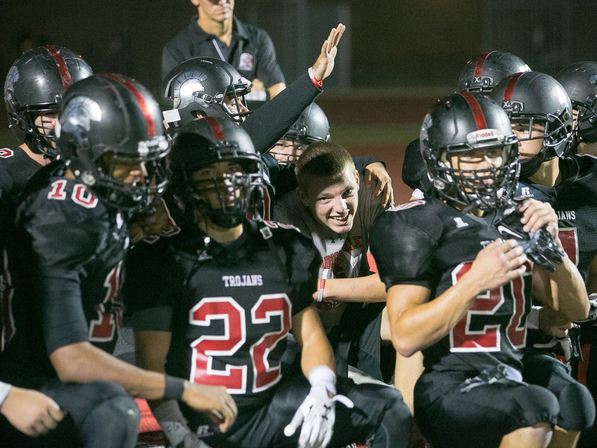 Phoenix Paradise Valley football players celebrate their win after their high school football game against Laveen Betty Fairfax in Phoenix on Friday, August 28, 2015.