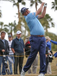 Jason Dufner tees off on the 9th hole at the Jack Nicklaus