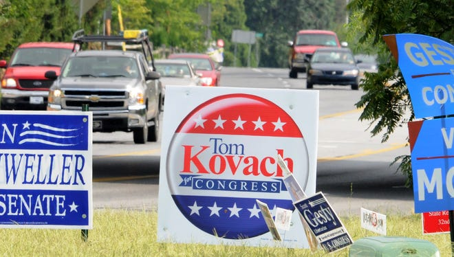 Campaign signs are jammed along U.S. 13 in Dover before the 2012 election.