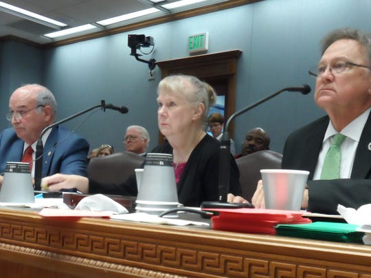 Reps. Terry Brown (left) and Gene Reynolds (right) are joined by New Iberia chemist Wilma Subra as they talk about their House Bill 11 to ban open burning of munitions and explosives during a House committee hearing.